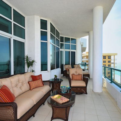 Oceanfront Penthouse Balcony by Talie Jane Interiors