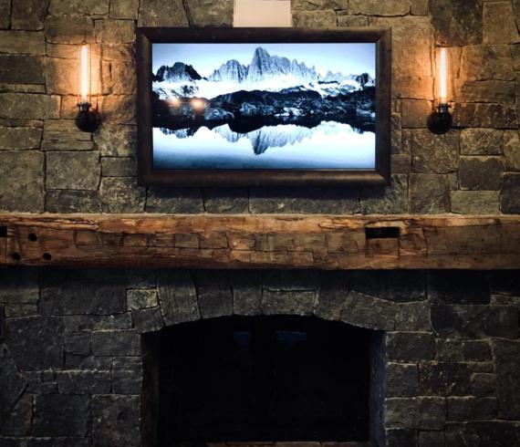 Framed Flat Screen TV above the mantel - Talie Jane Interiors