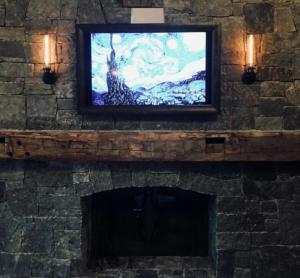 Framed Flat Screen TV above mantel - Talie Jane Interiors
